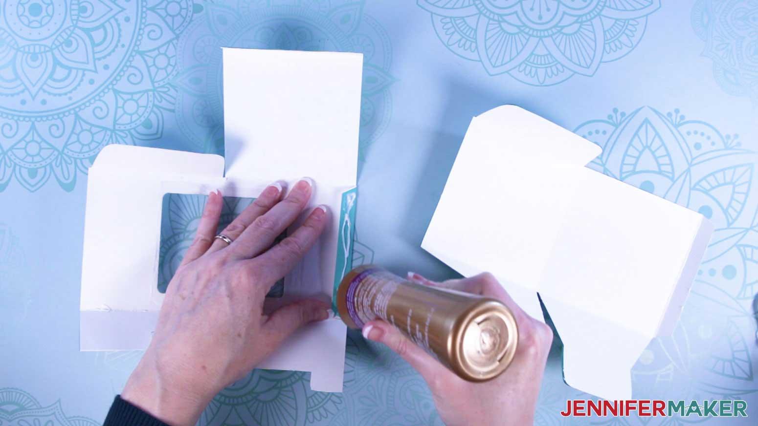 Apply glue to tab of mug gift box with a window
