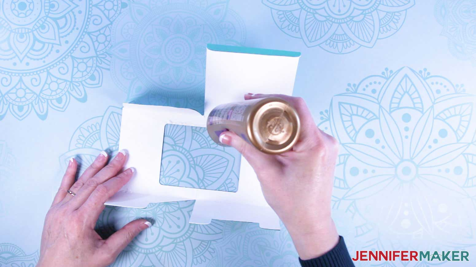 Apply glue around window interior of mug gift boxes