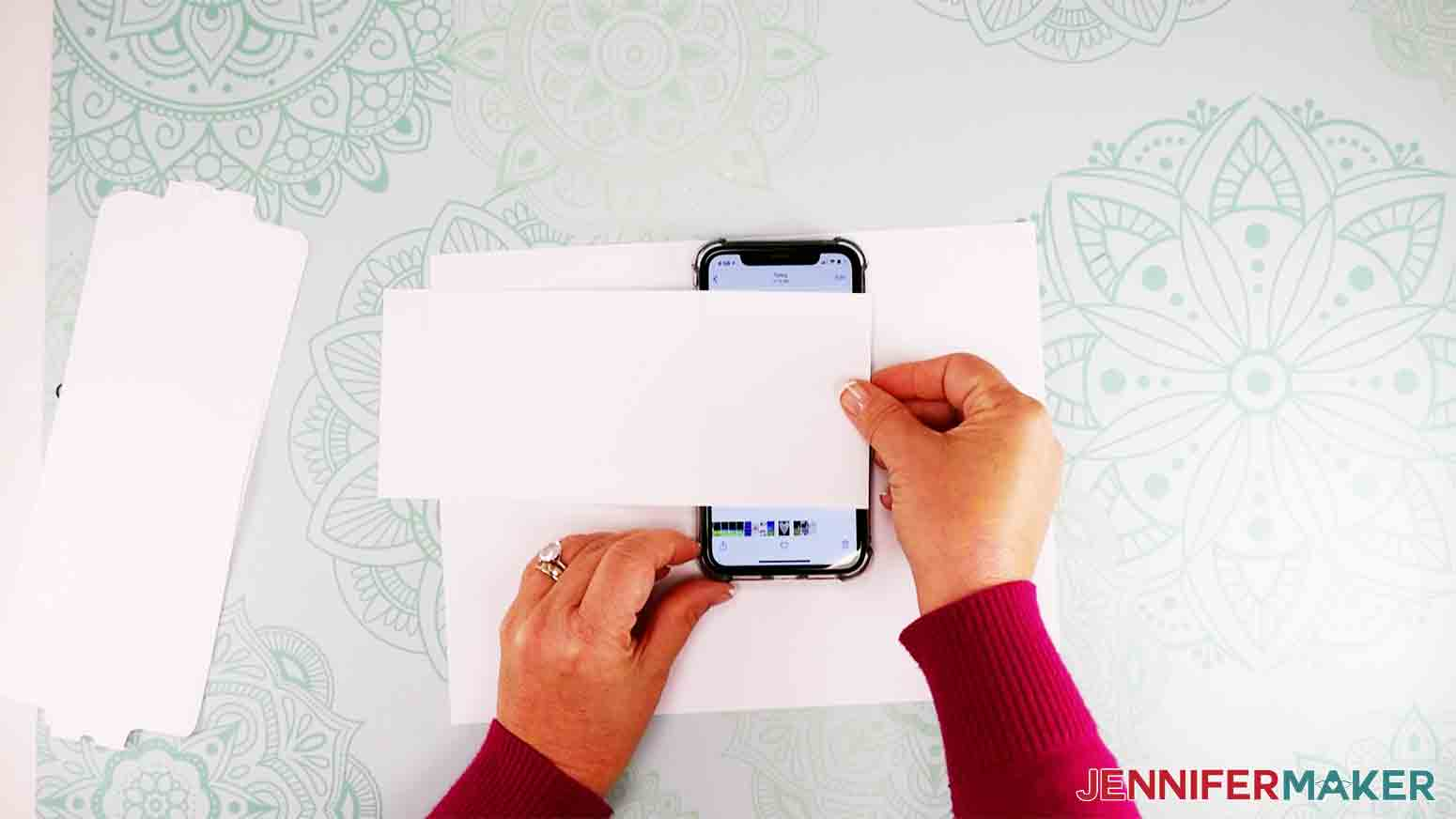 showing copy paper over iphone to trace