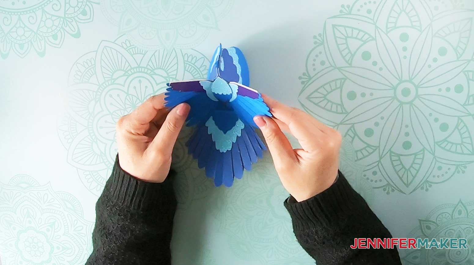 Fold and arrange the paper bird wings and tail