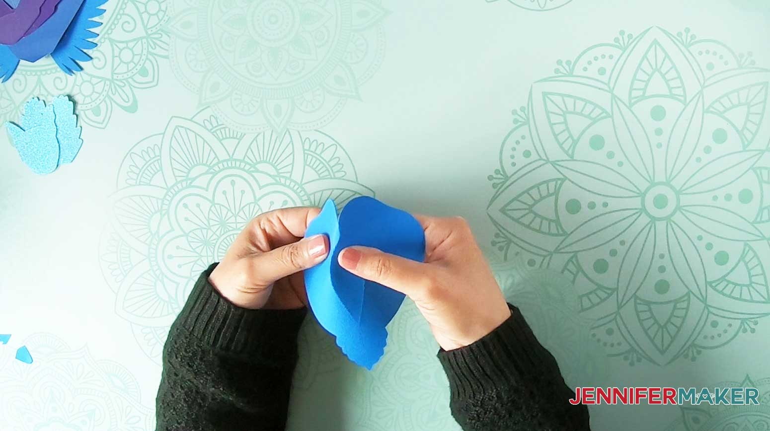 Fold the paper bird body into a 3D shape
