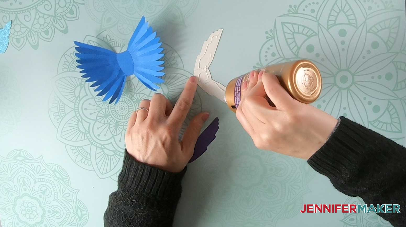 Apply glue to the paper bird decorative accent pieces