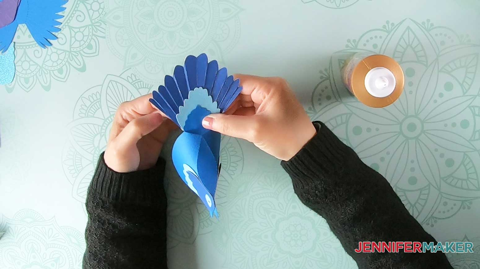 Glue the tail onto the paper bird body