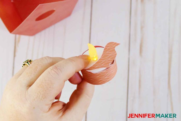 Wrap the paper bird around the tealight to make a bird nest