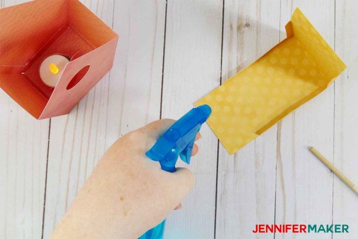 Spray the edges of your roof lightly if you have issues rolling them for your paper birdhouse
