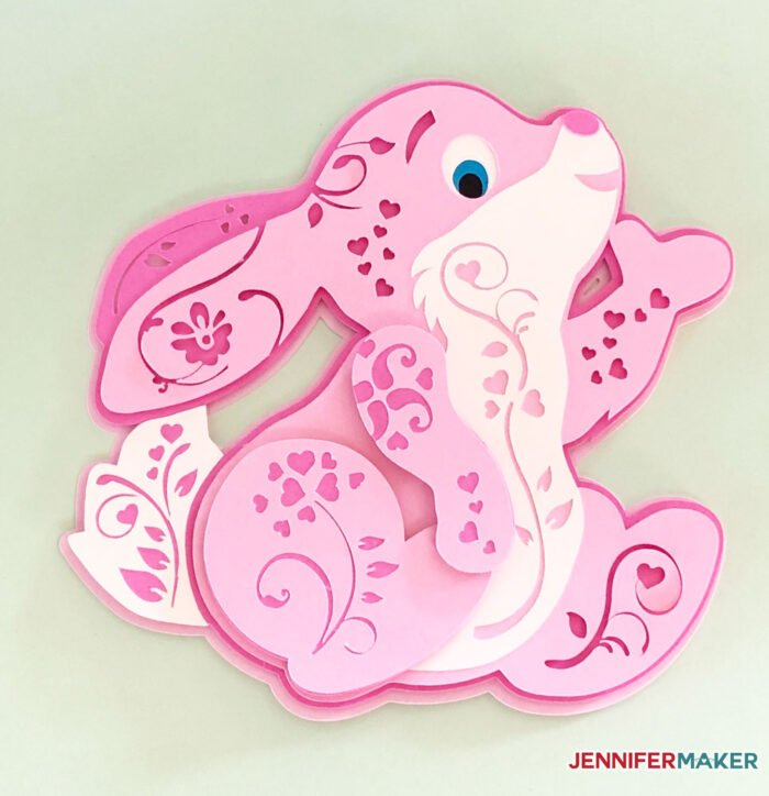 Pink paper bunny in a 3D filigree style