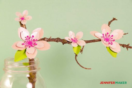 Paper cherry blossom flowers on a branch
