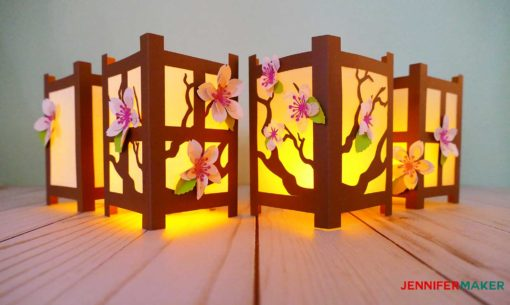 Paper cherry blossom flowers on Japanese paper lanterns