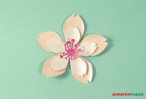 Glue a stamen to the center of your petals to make your paper cherry blossom flower