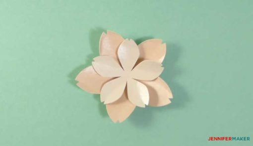Glue the smaller petals on top of the larger petals to make your paper cherry blossom flower