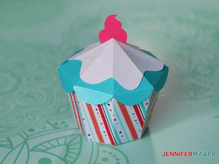 Cute paper cupcake shaped gift box in red, white, and blue