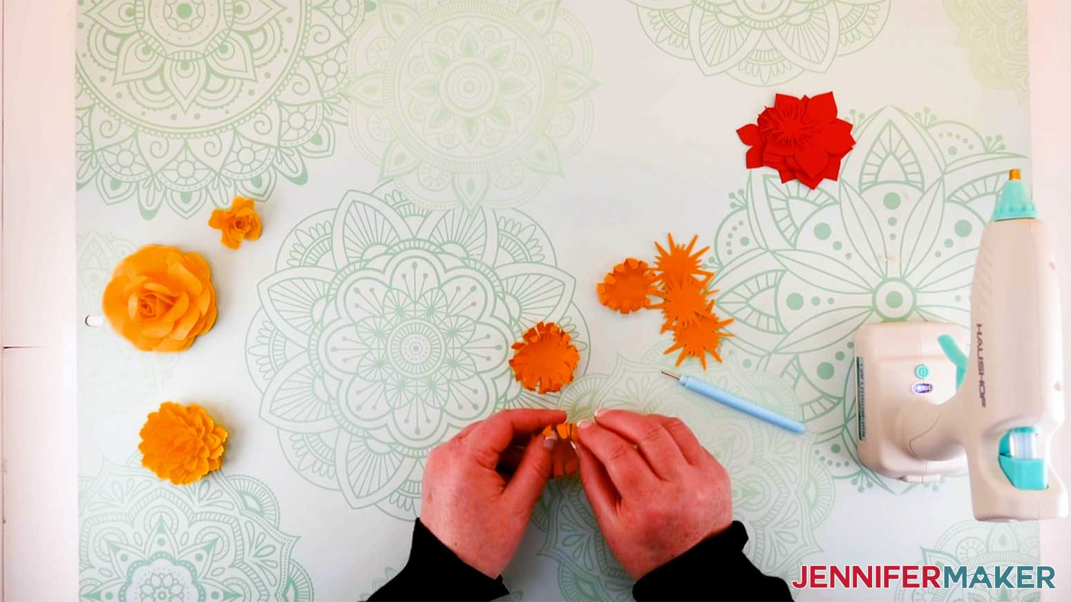 curling the petals of the paper flower mum for my paper flower letter
