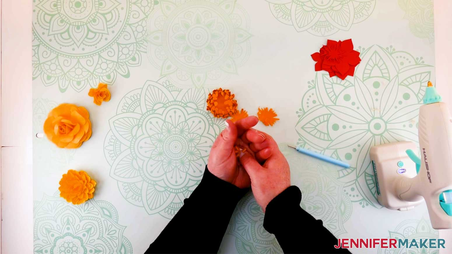 Mold the petals to the paper flower mum in the palm of your hand for my paper flower letter