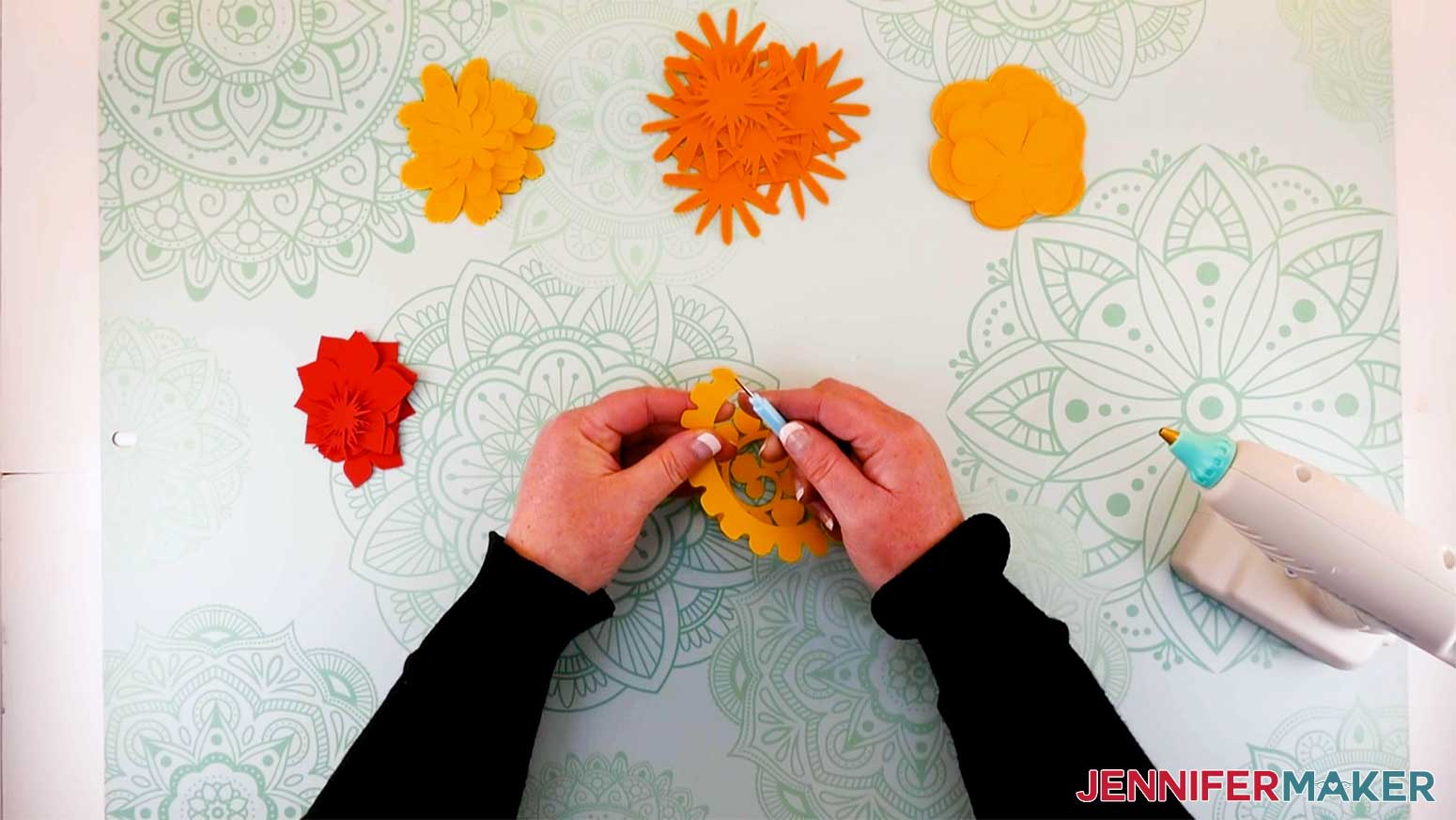Place the flower end on the quilling tool to prepare for rolling for my paper flower initial