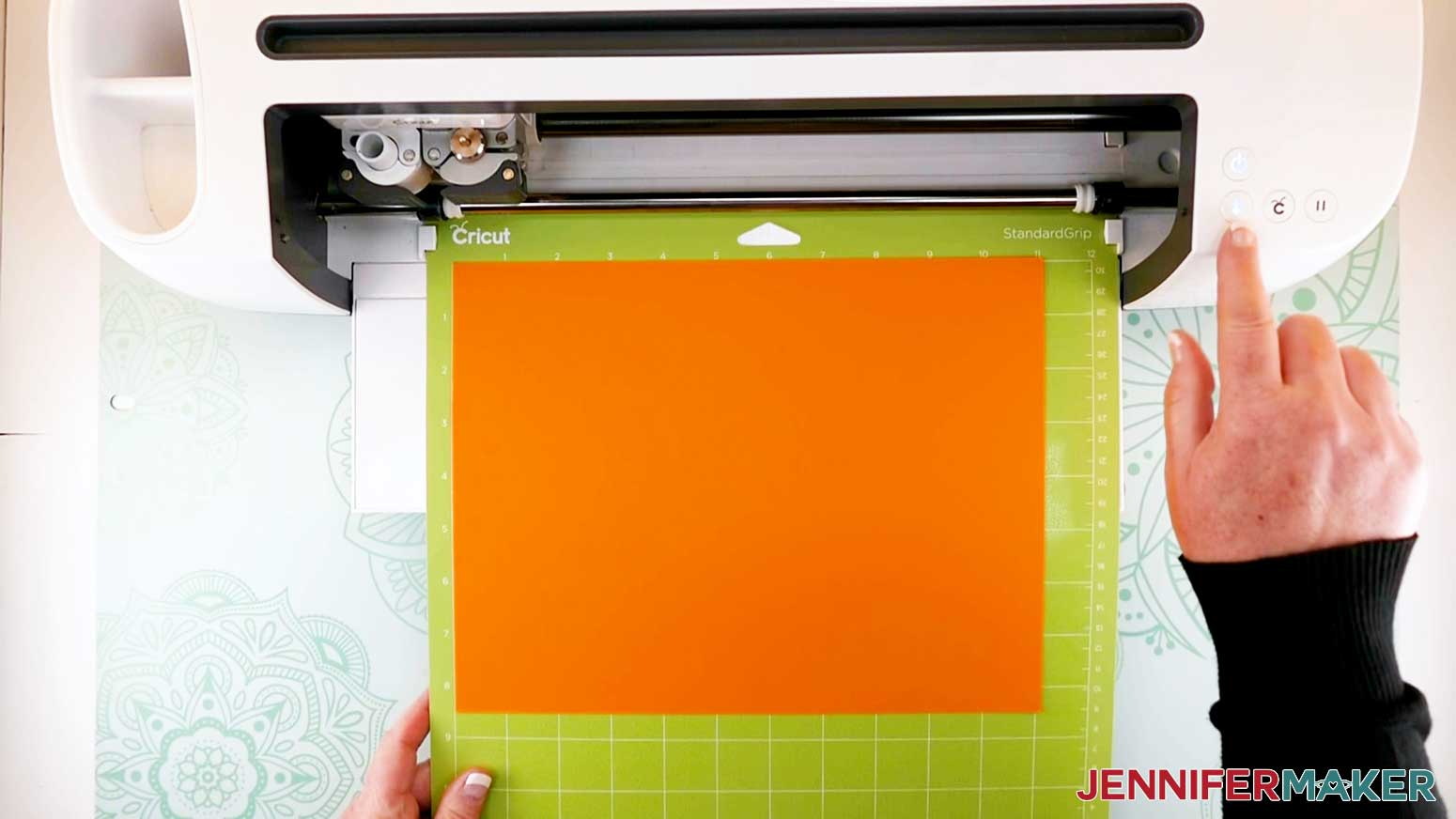 loading mat into cricut machine for the paper flower letter project