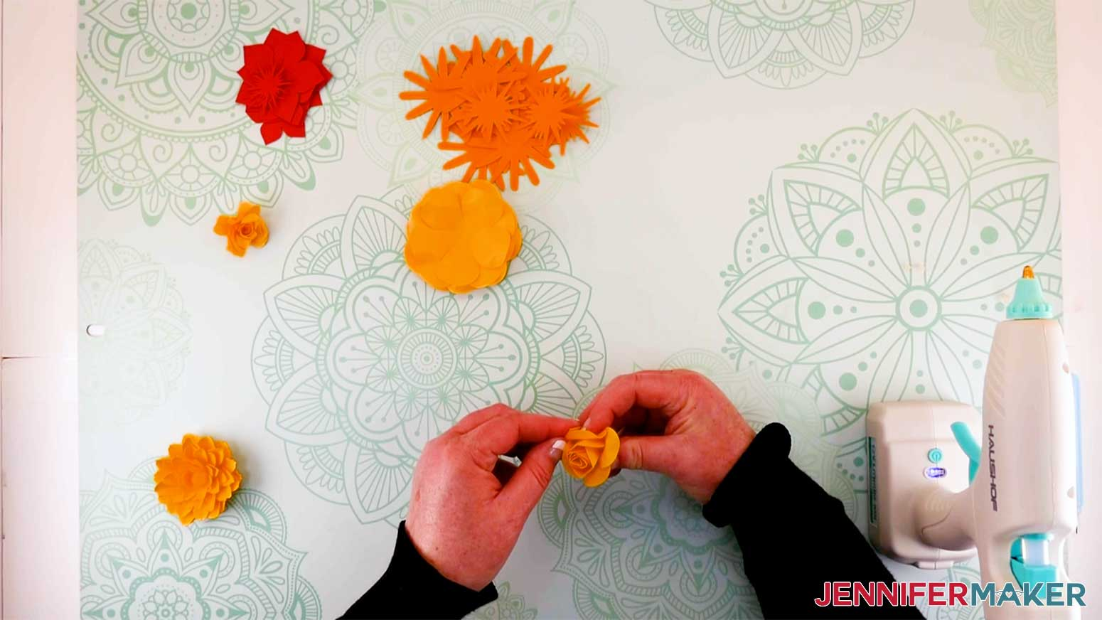 shaping the center of the paper flower before gluing in place for my paper flower letter