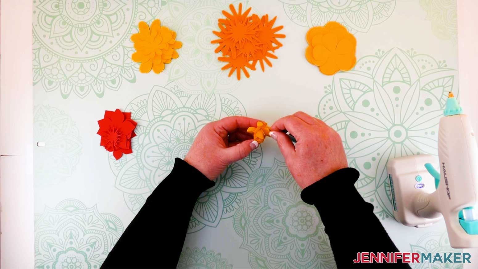 Curl the petals of the flower to shape my paper flower letter