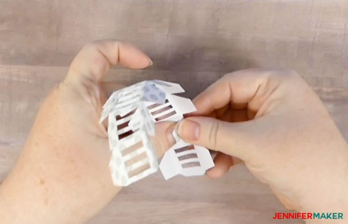 Folding the roof cap to make paper gazebo luminaries