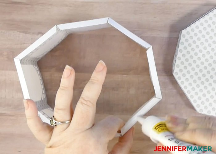 Glueing the bottom tabs of the paper gazebo luminary