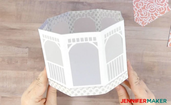 Gluing the sides of the paper gazebo luminary