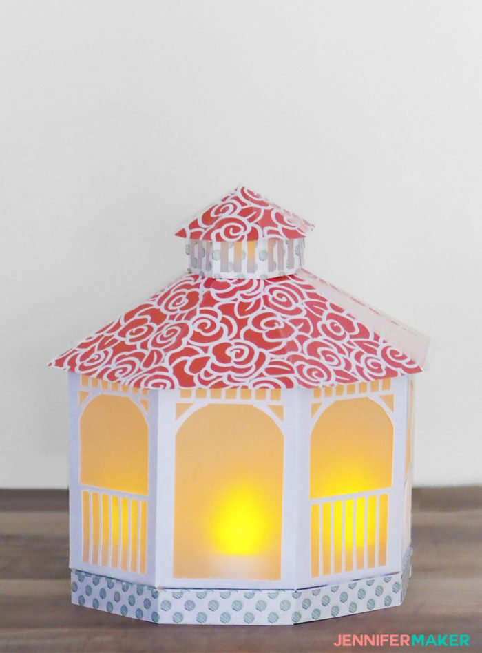 Light up a paper gazebo luminary lit up with LED tealights for parties and gifts! Get a free template and tutorial to make your own #papercrafting #cricut #gazebo