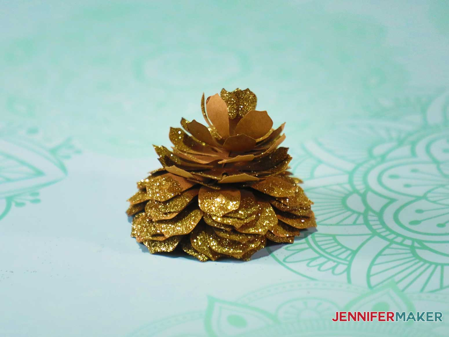 Single glittery paper pinecone