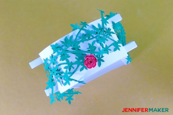 Glue the roses to the vines to make Paper Rose Arbor Luminary