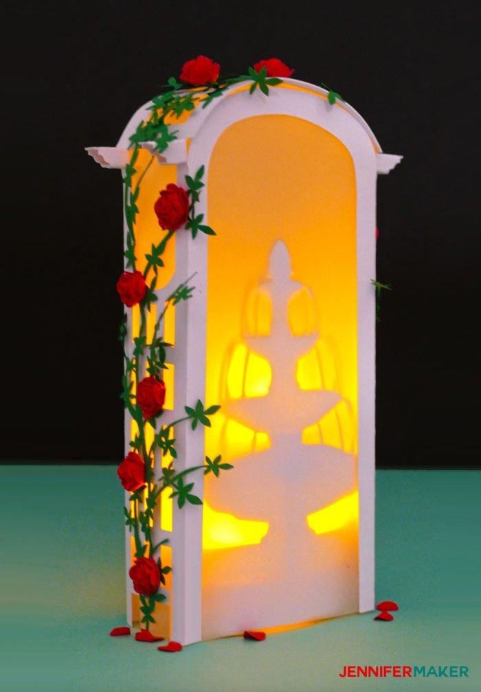 Make a Paper Rose Arbor Luminary for wedding decor, parties, centerpieces, and memorials #cricut #papercraft #paperflowers #luminary #diy #weddingdecor