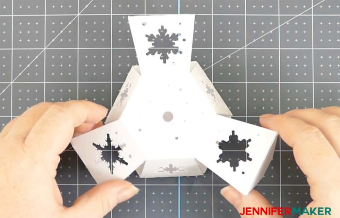 Three sides of the base glued for the Paper Snowflake Christmas Tree Luminary
