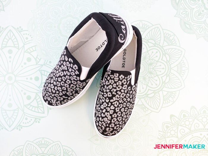 Personalize your shoes with animal print in silver glitter iron-on vinyl on black canvas shoes.