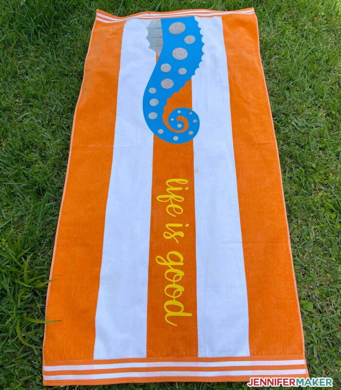 Orange towel with Smart Iron On Vinyl in yellow, blue, and silver with a seahorse!