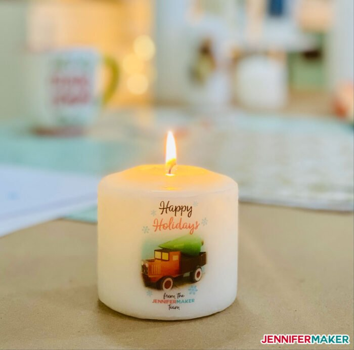 White pillar candle with printed image transferred onto it for the holidays
