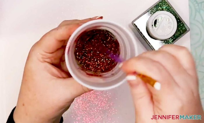 Combining red and green glitter to make a glitter mix for the plaid glitter tumbler