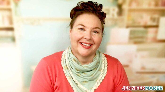 Jennifer Maker wearing a pretty scarf face mask in light green fabric
