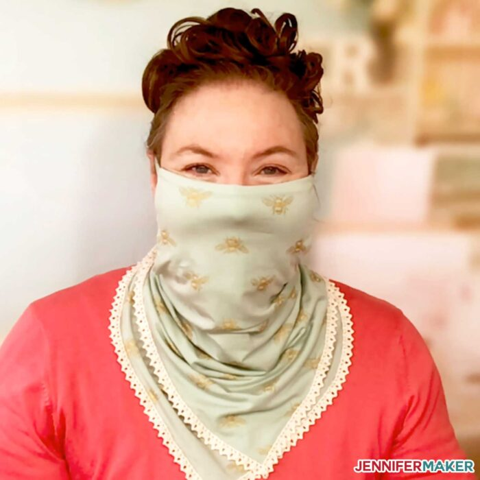 Jennifer wearing the pretty scarf face mask in mint green with off white trim