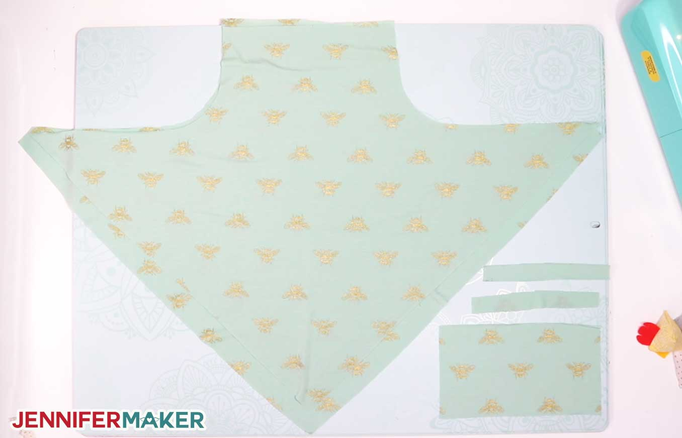Cut fabric pieces to make the pretty neck scarf face mask