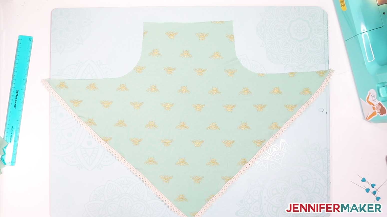 The pretty scarf face mask with trim sewn on the edges