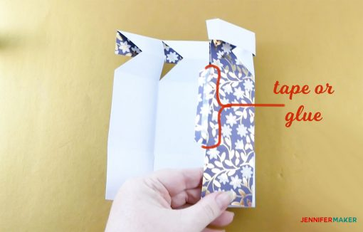 Tape or glue the two sides together in the middle of your pull-up gift box