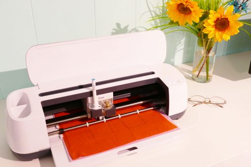 Cutting out the pumpkin pie plushie on the Cricut Maker
