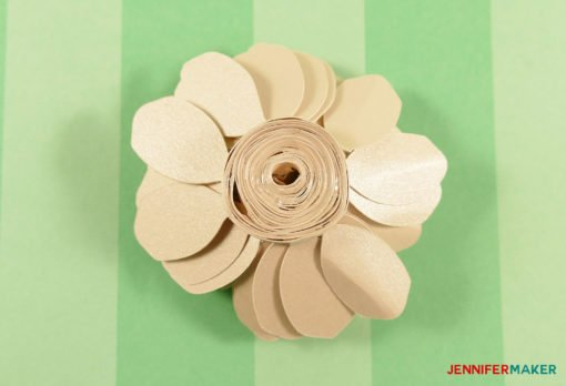 Glue on the bottom of the quilled paper gardenia flower