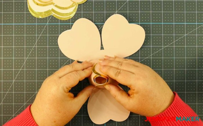 Gluing petals to make a rose gold paper flower