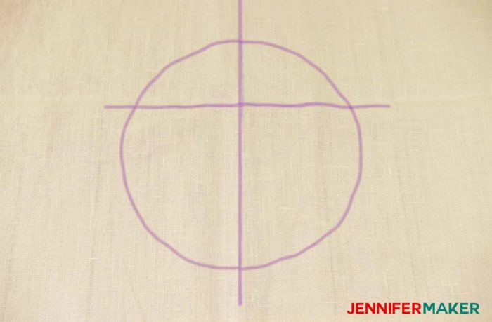 A marked circle on fabric to sew a round jewel neckline on a shirt or tunic
