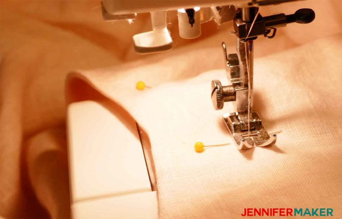Sewing down the facing on the tunic to sew a round jewel neckline on a shirt or tunic