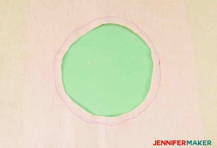 Cut out the circle of the facing to sew a round jewel neckline on a shirt or tunic