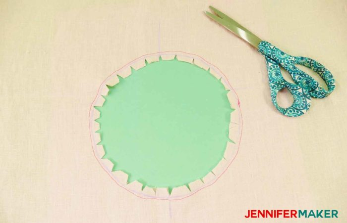 Make small cuts inside the perimeter of the circle to sew a round jewel neckline on a shirt or tunic