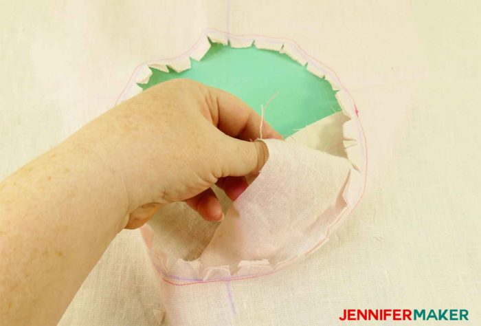 Pulling the facing inside out to sew a round jewel neckline on a shirt or tunic