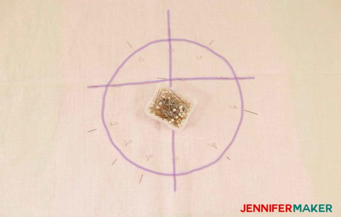 Pin the square facing to the fabric to sew a round jewel neckline on a shirt or tunic