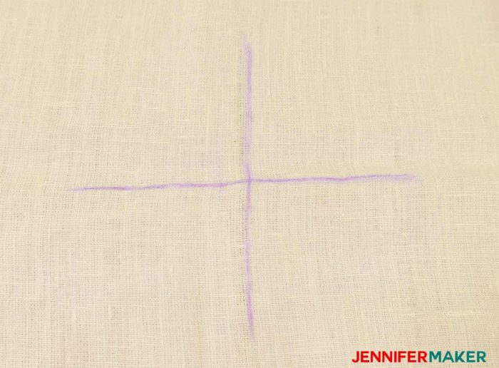 Mark a big cross on your garment to sew a round jewel neckline on a shirt or tunic