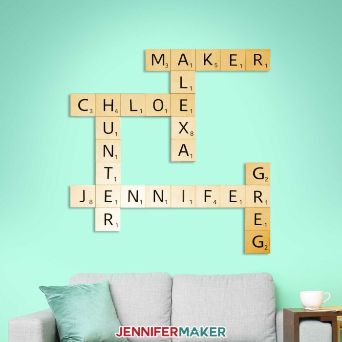 Scrabble tiles wall art with light wood tiles and black vinyl in a living room