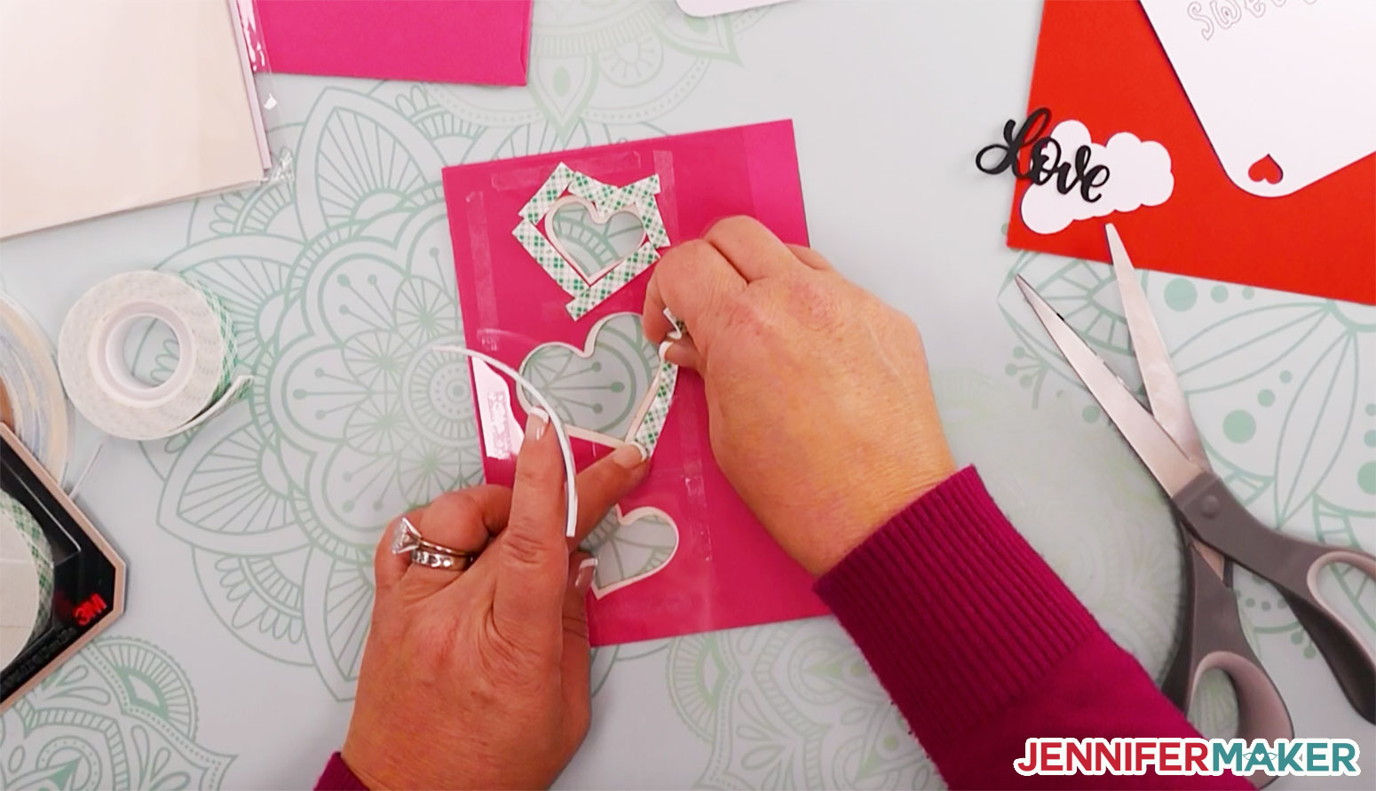 Placing foam tape around the perimeter of the hearts to create a well for the shaker card contents